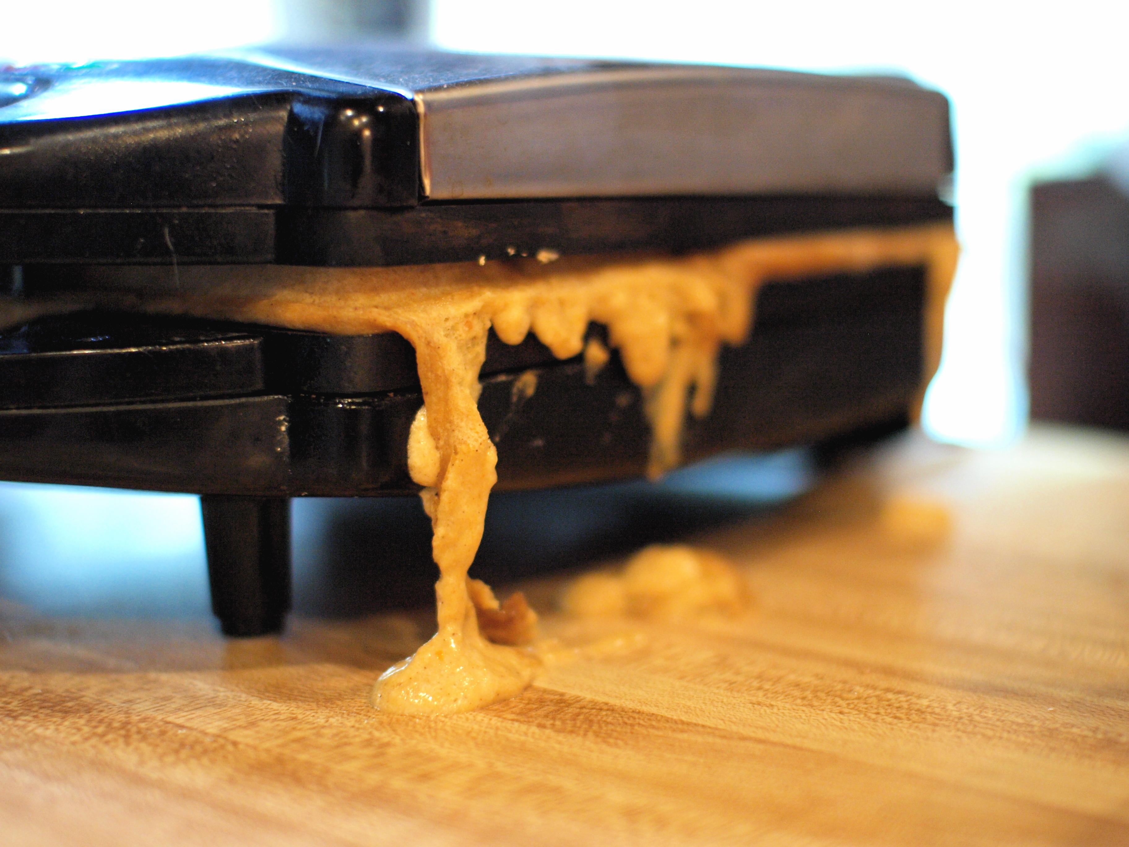 pumpkin waffle batter overflowing